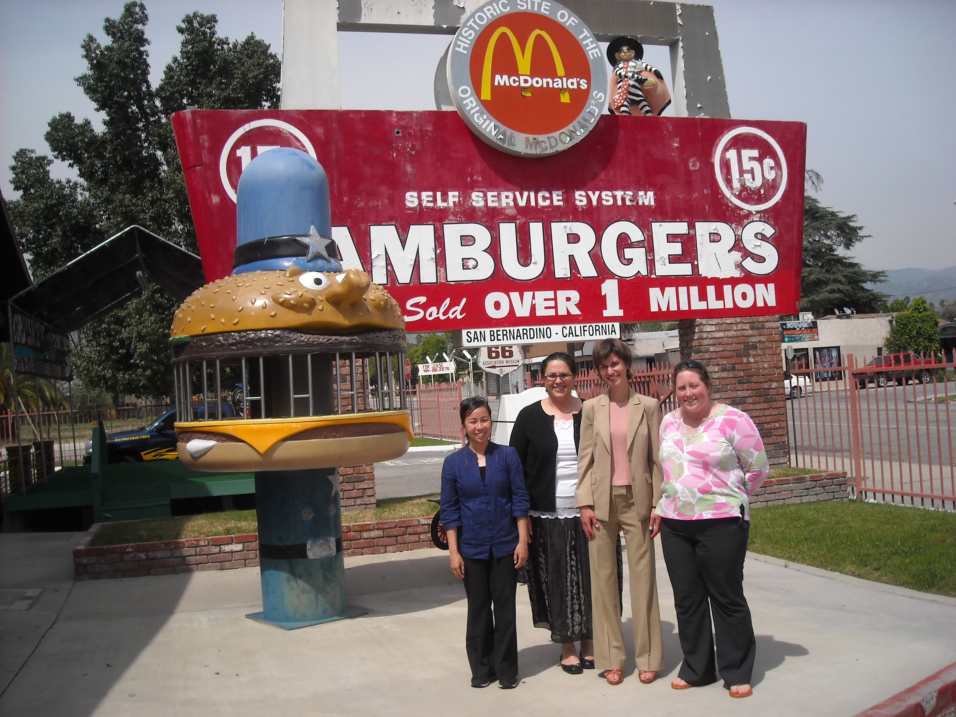 Dr. Varzally poses in front of McDonald's location for oral history project