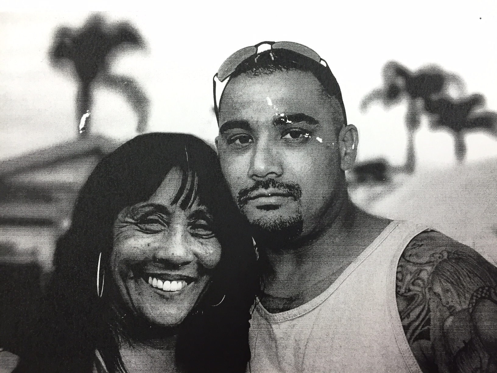 Theresa Smith smiling with her son Caesar Cruz