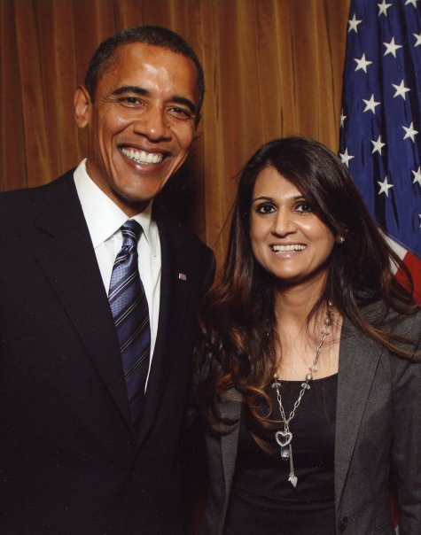 Anila Ali poses with President Obama with a US flag next to them