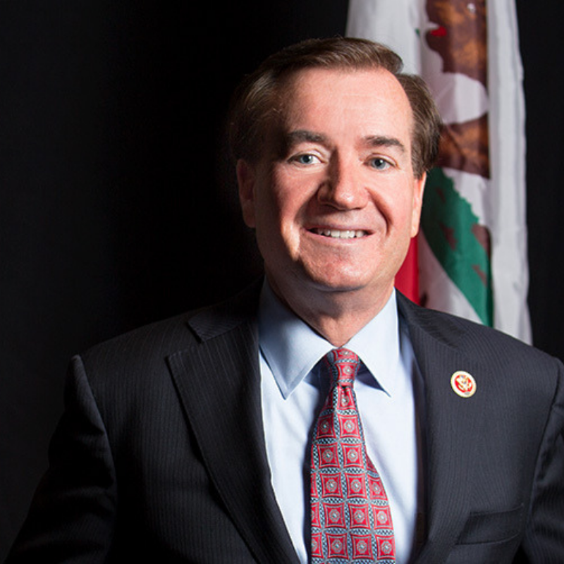 United States Representative Ed Royce standing in front of California state flag