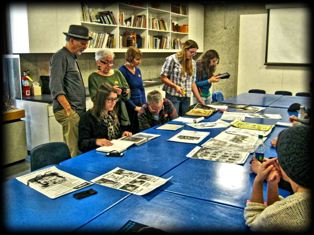 public history students look over archival materials for the Keystone exhibit